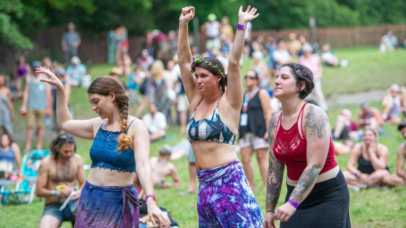 From left, Michelle Nowak, Amber Midgley, and Alyssa Dunn dance to Vannesa Collier's blues performance. (Jonathan Wilson for WHYY)