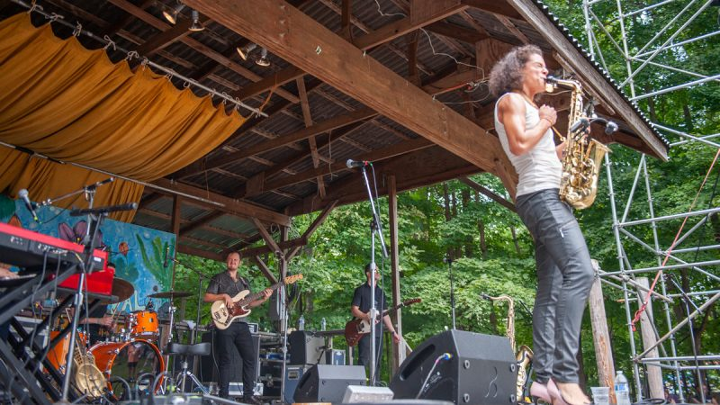 Blues, soul, and funk artist Vanessa Collier brought her five-piece band to the Camp Stage at the folk festival. (Jonathan Wilson for WHYY)