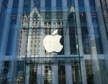 Apple, the world's most valuable publicly traded company, became first to reach the milestone $1 trillion market value. (Don Emmert/AFP/Getty Images)