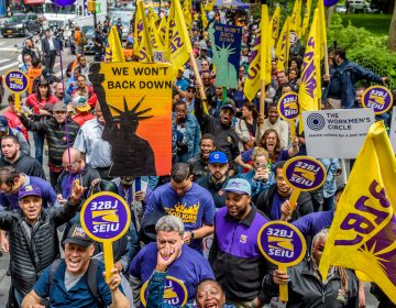 Cashiers, cooks, delivery people, fast-food workers and their supporters rallied outside New York City Hall in 2017. Their influential union, the Service Employees International Union, also includes about half a million home health aides. (Pacific Press/LightRocket/Getty Images)