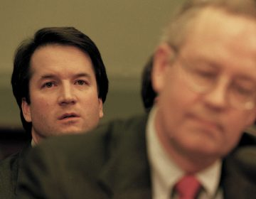 Brett Kavanaugh sits behind independent counsel Kenneth Starr as Starr testifies before the House Judiciary Committee on the possibility of former President Bill Clinton's impeachment in 1998.