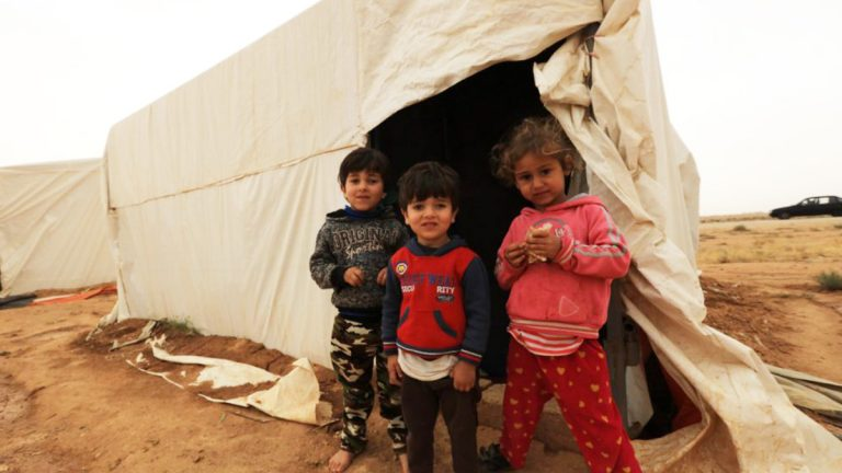 MAFRAQ, Jordan — Syrian refugee children at a settlement near the Jordan-Syria border on April 26, 2018. (© Mohammad Abu Ghosh/Xinhua via ZUMA Wire)