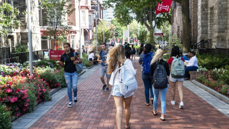 Students walk on the Temple University campus in Philadelphia. Temple has started a master's degree in sport business, among the 41,446 degree or certificate programs colleges and universities have added since 2012. (Matt Rourke/The Associated Press)