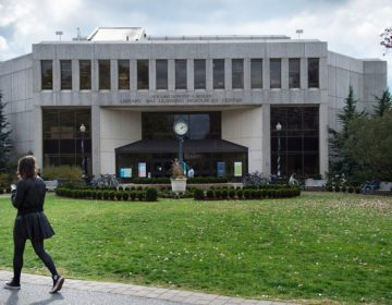 A student walks past the Bender Library on the American University campus in Washington, D.C. American is one of 32 colleges and universities with an accelerated program that lets students earn bachelor's degrees in thee years instead of four, which one management expert has criticized for helping only undergraduates who are already very well prepared. (Nikki Kahn/The Washington Post via Getty Images)
