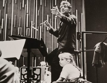 Jamie Bernstein watches her father, Leonard Bernstein, conduct the New York Philharmonic at a rehearsal for one of his Young People's Concerts, circa fall 1962. (Bob Serating /New York Philharmonic Leon Levy Digital Archives)