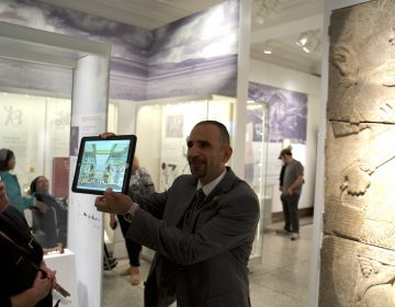 Iraqi artist Yaroub Al-Obaidi gives a tour of the Penn Museum's new Middle East Galleries. He'll also be reading this weekend at an event that brings together Iraqis and veterans of the Iraq War. (Jen Kinney)