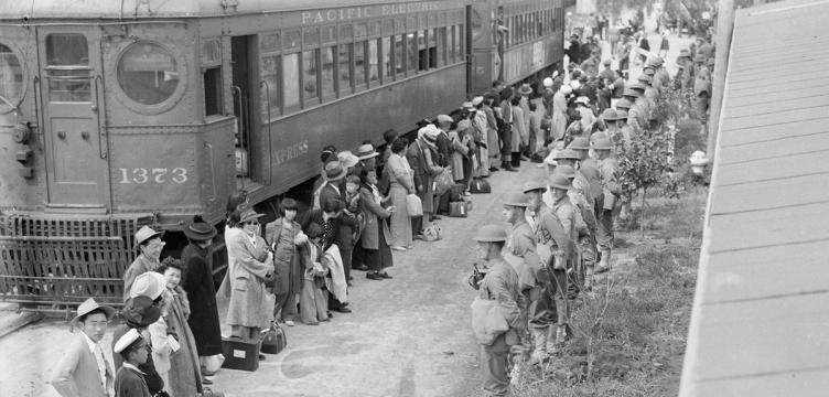 People of Japanese ancestry arrive at the assembly center at Santa Anita Racetrack in Arcadia, Calif., in 1942 for internment. (National Archives and Records Administration)