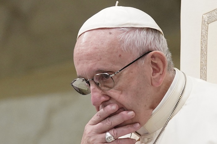 FILE - In this Aug. 22, 2018 file photo, Pope Francis is caught in pensive mood during his weekly general audience in the Pope Paul VI hall, at the Vatican. Archbishop Carlo Maria Vigano, with his 11-page testimony, have thrown Francis' 5-year papacy into crisis. (AP Photo/Andrew Medichini)