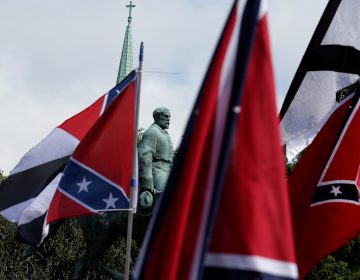 Members of white nationalist groups gathered around a statue of Robert E. Lee during a rally in Charlottesville, Va., on Aug. 12, 2017. (Joshua Roberts/Reuters)