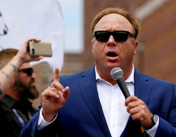 Alex Jones, shown here at a July 2016 rally in support of then-candidate Donald Trump, says he is being subjected to a