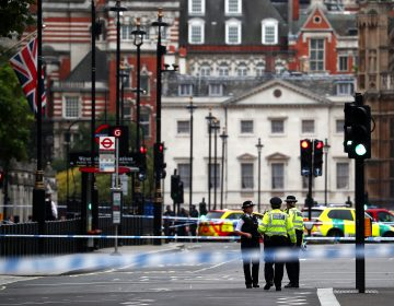 Police stand in the street after a car crashed outside the Houses of Parliament in Westminster, London, Britain,on Tuesday