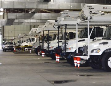 Early in the morning, Duquesne Light crews prepare their trucks for the day ahead installing new transformers, poles and auto-switches to reroute power around outages. (Amy Sisk / StateImpact Pennsylvania)