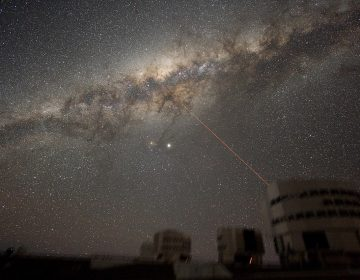 The Milky Way's Galactic Center in the night sky above the Paranal Observatory (the laser creates a guide-star for the telescope). ESO/Y. Beletsky