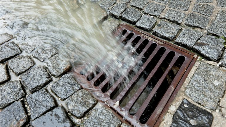 Metal lid of a channel for rain water (bigstockphoto.com)
