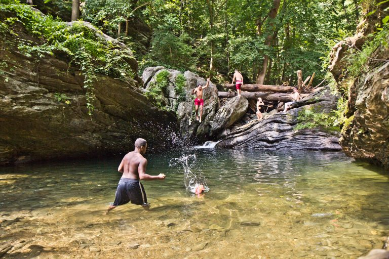 Swimmers cool off in the Devil's Pool in Fairmount Park in Philadelphia. (Kimberly Paynter/WHYY)