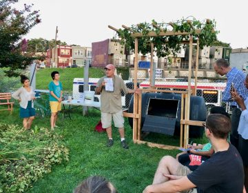 Tony Guido explains features of a composting vessel he helped build for a Philadelphia Food Policy Advisory Council design competition. (Meir Rinde/PlanPhilly)