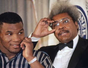 Mike Tyson, left, stands with fight promoter Don King during a news conference on Wednesday, June 25, 1987. (AP Photo/Paul Burnett)