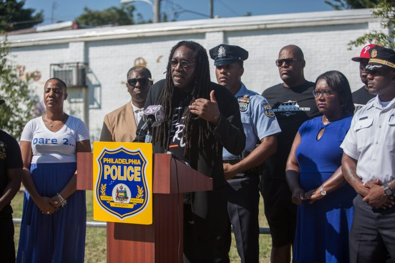 J. Jondhi Harrell is the executive director of The Center for Returning Citizens, which has partnered with the Philadelphia Police Department in an initiative to link employers with potential employees on Southwest Philadelphia street corners. (Emily Cohen for WHYY)