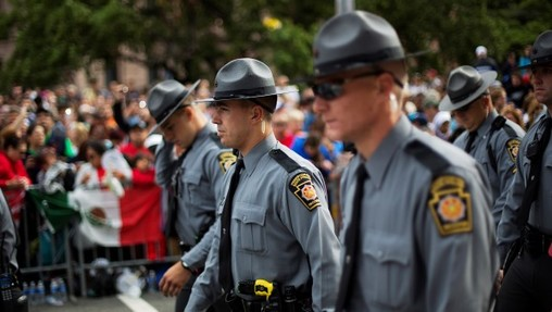 State police will now be required to make more visits to schools. (AP Photo)