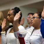 A naturalization ceremony takes place at the U.S. Citizenship and Immigration Service in Philadelphia last year. (Bastiaan Slabbers for WHYY, file)