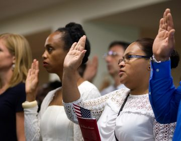 A naturalization ceremony takes place at the U.S. Citizenship and Immigration Service in Philadelphia. (Bastiaan Slabbers for WHYY, file)