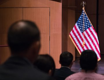 Newly sworn-in U.S. citizens gather for a naturalization ceremony in Alexandria, Va., in August. A potential trial over a new 2020 census citizenship question is set to start on Nov. 5 in New York City. (Claire Harbage/NPR)