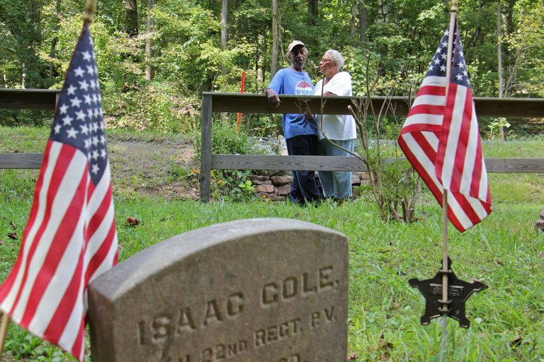 John Cole and his wife, Barbara, visit the tiny graveyard where his great grandfather Isaac Cole, is buried. Isaac Cole was a Civil War veteran and worked as a woodsman for the nearby Hopewell Furnace.