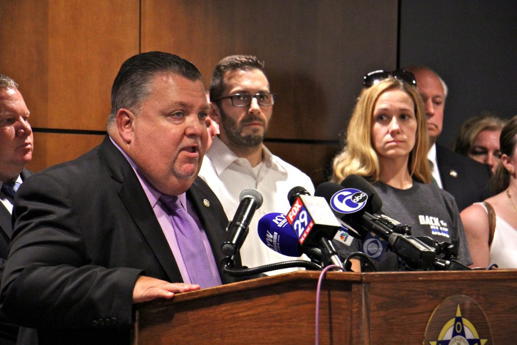 Philadelphia Fraternal Order of Police President John McNesby speaks in support of ex-police officer Ryan Pownall, charged with murder in the shooting of David Jones. Pownall's family members (from right) wife Tina Pownall and brother Edward Pownall, look on.