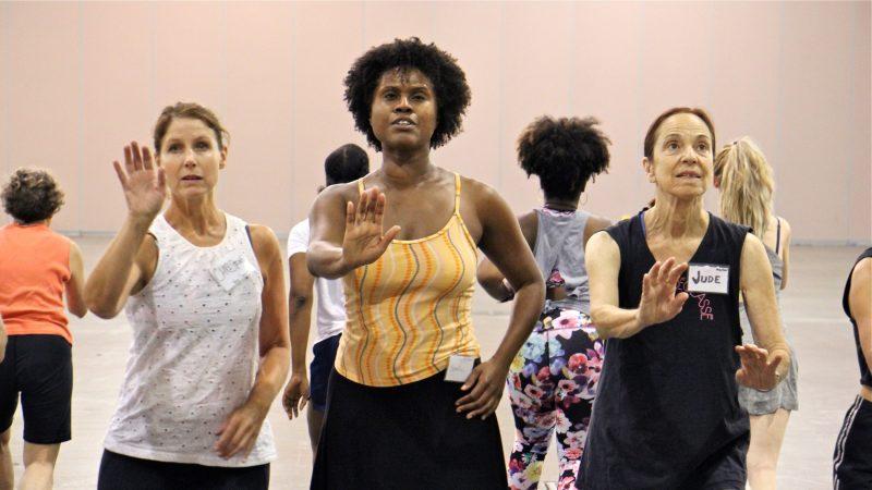 Volunteer dancers rehearse for