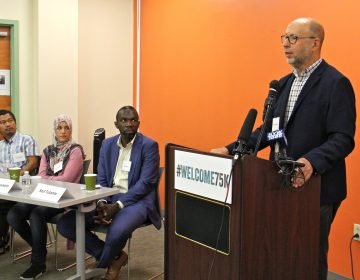 Dr. David S. Glosser speaks in support of the U.S. Resettlement Program. He is joined by former refugees (from left) Gin Sum, who fled religious persecution in Burma, Bdour Hussein, who fled the war in Syria, and Sozi Tulante, who came to Philadelphia as a political refugee in 1983.
