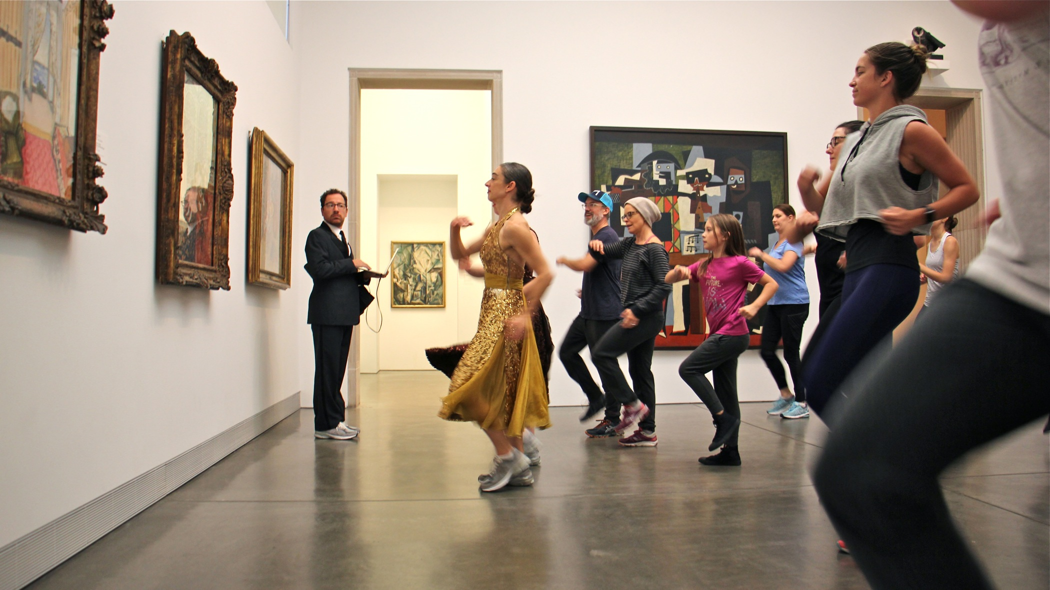 "Monica Bill Barnes and Anna Bass lead ""The Museum Workout"" at the Philadelphia Museum of Art. The soundtrack for the performance is provided by Robbie Saenz de Viteri (left)."