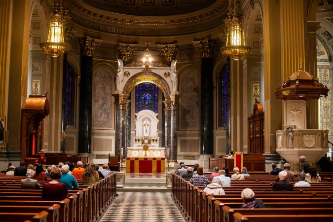 Philadelphia area catholics attended a mass Friday evening at the Basillica of Saints Peter and Paul for a night of prayer and reflection following the recent revelations of wide spread sexual abuse by priests across the state. (Brad Larrison for WHYY)