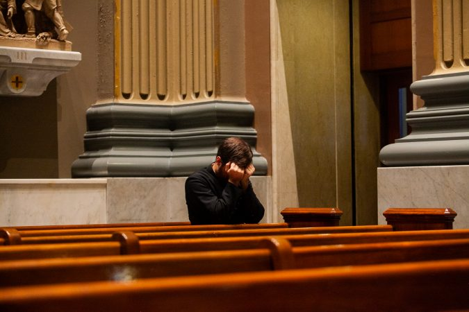 Clergy attended a mass Friday evening at the Basillica of Saints Peter and Paul for a night of prayer and reflection following the recent revelations of wide spread sexual abuse by priests across the state. (Brad Larrison for WHYY)