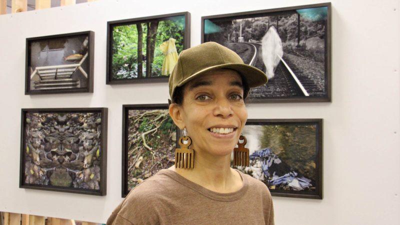 Andrea Walls stands before her exhibit,