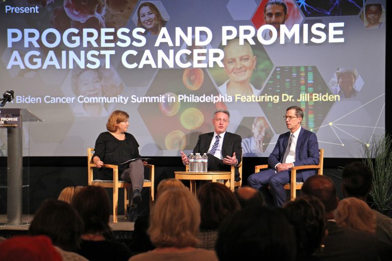 Dr. Dario Altieri (center), president and CEO of the Wistar Institute, talks about the road to FDA approval for cancer treatments during a discussion with Abramson Cancer Center Director Robert Vonderheide (right). The discussion was moderated by Maiken Scott (left), host of WHYY's The Pulse. (Emma Lee/WHYY)