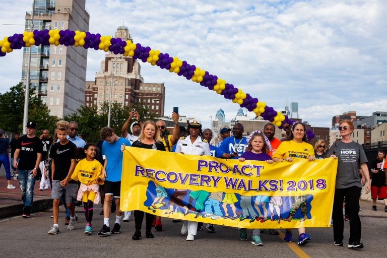 Participants in the 2018 Recovery Walk return to Penn's Landing Saturday morning. (Brad Larrison for WHYY)