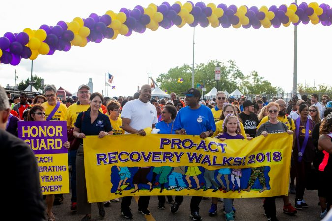 Participants in the the 2018 Philadelphia Recovery walk begin the march through Old City Saturday morning at Penn's Landing. (Brad Larrison for WHYY)