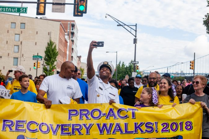 U.S. Surgeon General Jerome Adams takes a selfie with participants in the 2018 Recovery Walk. (Brad Larrison for WHYY)