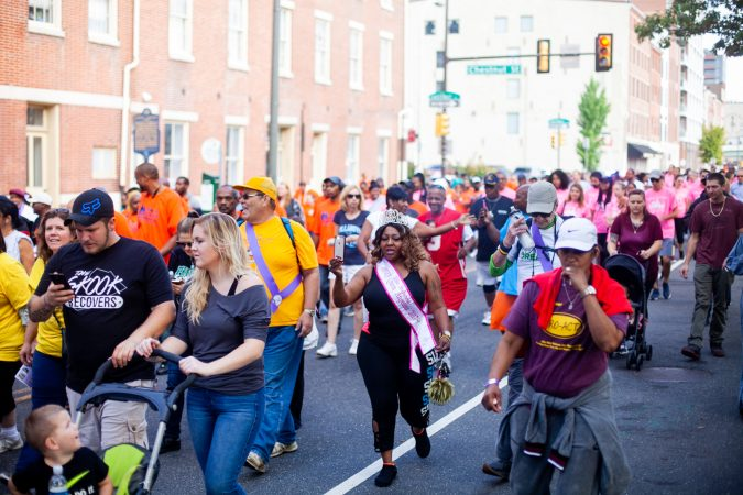 Participants in the 2018 Recovery Walk march through Old City Philadelphia Saturday morning. (Brad Larrison for WHYY)