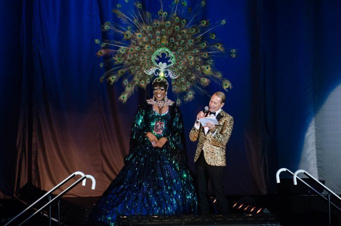 A former Miss'd America winner talks with host Carson Kressley during the Miss'd America Pageant held at the Borgata in Atlantic City. (Anthony Smedile for WHYY)