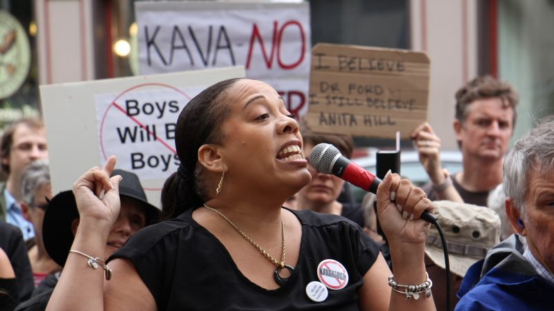 Kadida Kenner, campaign director of Why Courts Matter Pennsylvania, speaks to about 200 protesters gathered outside the United States Custom House at 200 Chestnut Street to voice their objections to Brett Kavanaugh as a nominee for the U.S. Supreme Court in light of sexual assault allegations. (Emma Lee/WHYY)
