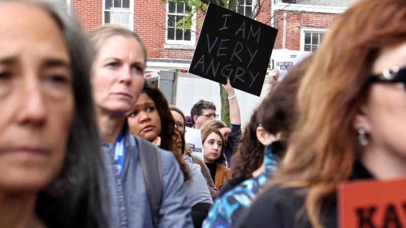 About 200 protesters gather outside the United States Custom House at 200 Chestnut Street to voice their objections to Brett Kavanaugh as a nominee for the U.S. Supreme Court in light of sexual assault allegations. (Emma Lee/WHYY)