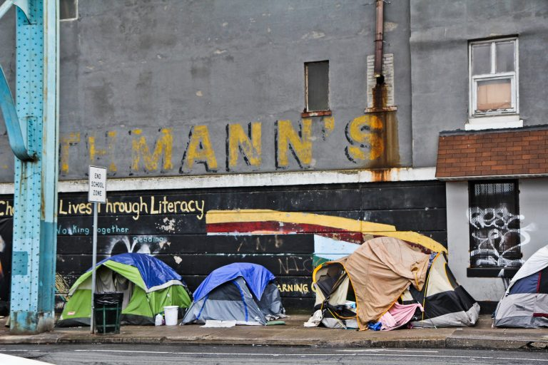 """People were evicted from an encampment at Kensington and Tulip Streets in May. The city of Philadelphia released its """"Roadmap to Homes"""" Wednesday, a plan to reduce street homelessness by 5 percent every year for the next five years. (Kimberly Paynter/WHYY)"""