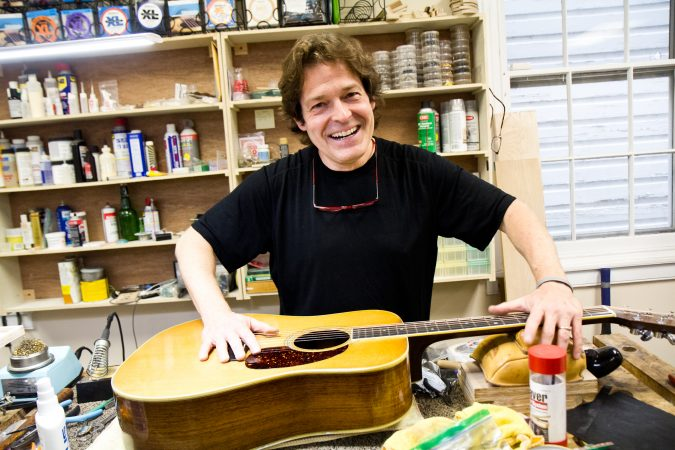 Tim Huenke is a restorative luthier and owner of Superior Guitar Works in Flourtown. (Kimberly Paynter/WHYY)
