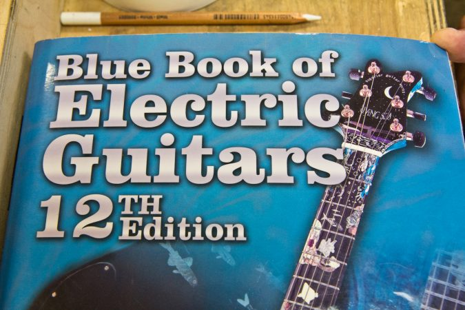 A guitar that Tim Huenke built with a biology teacher was pictured on the cover of the 12th edition of