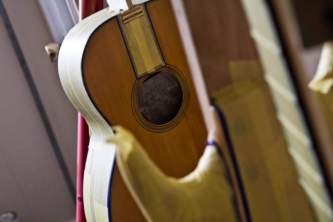 Guitars await the attention of restorative luthier Tim Huenke at Superior Guitar Works in Flourtown. (Kimberly Paynter/WHYY)