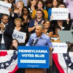 Former president Barack Obama campaigns for the re-election of U.S. Sen. Bob Casey and Gov. Tom Wolf at the Dell Music Center in North Philadelphia. (Kimberly Paynter/WHYY)