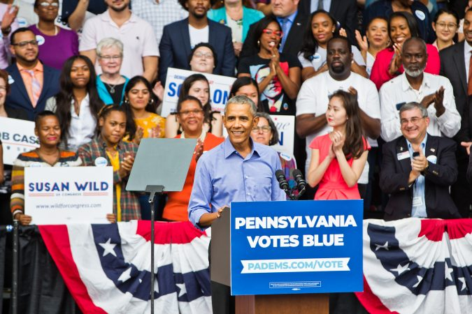 Former President Barack Obama has the crowd on its feet during a rally Friday in North Philadelphia. (Kimberly Paynter/WHYY)