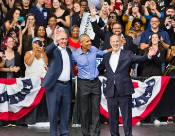 Former President Barack Obama campaigns with  U.S. Sen. Bob Casey (left) and Gov. Tom Wolf at the Dell Music Center in North Philadelphia. (Kimberly Paynter/WHYY)