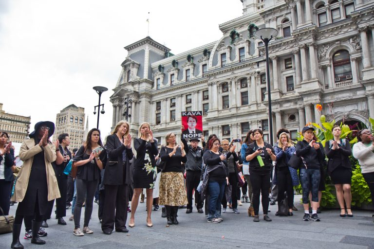 Women and allies gathered in Center City Philadelphia as part of a national walkout to show support for Christine Blasey Ford and Deborah Ramirez, two women who claim Supreme Court Judge nominee Brett Kavanaugh assaulted them. (Kimberly Paynter/WHYY)